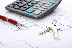 House plan. House plan, calculator and red pen over white Royalty Free Stock Image