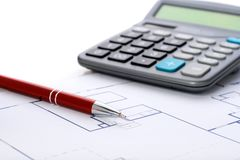 House plan. House plan, calculator and red pen over white Stock Image