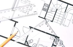 House plan. A pencil and geometric tools on top of a floor plan royalty free stock photography