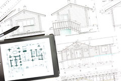House plan blueprints with tablet computer Stock Photos