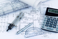House plan with calculator. An architect's blueprint with a calculator. photo icon for financing and planning of a new house Royalty Free Stock Photo