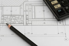 House plan with calculator and a pencil Royalty Free Stock Photos