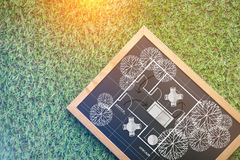 House plan on chalkboard on grass background Royalty Free Stock Photos