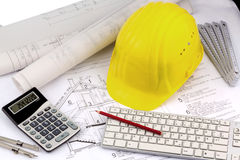 House plan with a construction worker's helmet Royalty Free Stock Photo