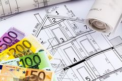 House plan with euro notes. A blueprint of an architect with euro money. symbolic photo for financing and planning of a new house Stock Image