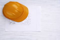 House plan and helmet. Architecture concept. Stock Photos