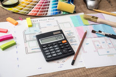House plan with a palette of colors and a calculator stock image