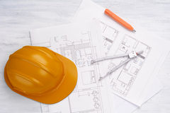 House plan with pencil, compass and helmet. Architecture concept Royalty Free Stock Photography