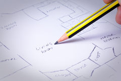 House plans. Freehand drawing a plan of a house Royalty Free Stock Photos