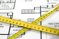 House plans and folding rule. Concept of home architecture Stock Image