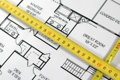 House plans and folding rule. Concept of home architecture Stock Photography