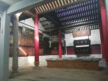 House of Plaques. Beutiful woden plaques line the walls of this antique Chinese hall. Original pillars are made of wood and stone Stock Image