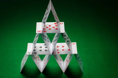 House of playing cards on green table cloth Royalty Free Stock Photography