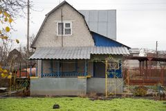 A house with a plot in the cottage.  Royalty Free Stock Photography
