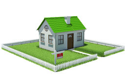 House on plot of grass with fence Stock Photos