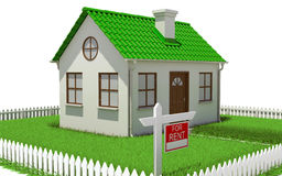 House on plot of grass with fence Stock Photography