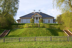 The house of the poet A. S. Pushkin in a manor Mikhaylovskoe in the may morning. Russia Royalty Free Stock Photos