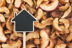House pointer, the price tag lies on  dried  apple Stock Photography