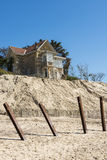 House with poles erosion at Beach Stock Photo