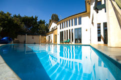 House with pool 1. Two storied residential home with swimming pool Royalty Free Stock Photography