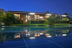 House and pool. View at night Royalty Free Stock Photo