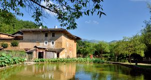 House beside pool, Guangdong, South of China. A farmer house beside pool, with vegetable fields, in Guangdong countryside, South of China Stock Photo