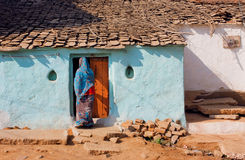 House of poor family and indian woman standing at the door Royalty Free Stock Photos