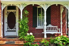 House porch. Beautiful porch of victorian house decorated with flowers Stock Photo