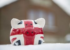 House price freeze piggy bank stock photo