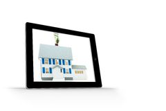House with price tag on tablet screen Royalty Free Stock Photography