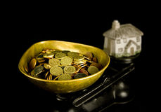 House prices. Money and a house on scales Stock Images