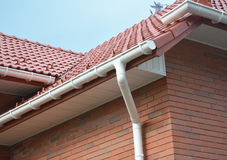 House Problem Areas for Rain Gutter Waterproofing. Guttering, Gutters, Plastic Guttering, Guttering, Drainage. Guttering Down pipe. Close up view on House Stock Photography