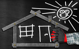 House Project - Metal Meter on Blackboard Royalty Free Stock Image