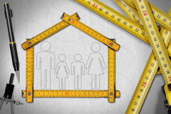 House Project - Meter Ruler with Family. House project concept. Meter ruler in the shape of house with symbol of a family, pencil, drawing compass and a group of stock illustration