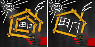 House Project - Wooden Meter on Blackboard. Hand holding a wooden meter ruler in the shape of house with sun, door, window and smoke from the chimney. On a vector illustration