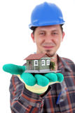 House project. Worker holding a house miniature in his hands, white background, isolated on white royalty free stock image