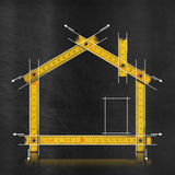 House Project - Yellow Wooden Meter. House project concept. Yellow wooden meter on blackboard with drawing of house royalty free illustration