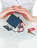 House is protected. A woman protects your house and home. good insurance and reputable financing calm Stock Photography