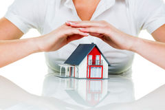 House is protected. A woman protects your house and home. good and reputable insurance financing calm Stock Photography