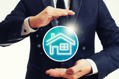 House protection and insurance. Concept with hand shielding gesture Royalty Free Stock Photos