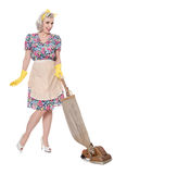 House proud retro housewife, with vintage vacuum cleaner, isolated on white,. Efficient retro housewife, with vintage vacuum cleaner, isolated on white, with Royalty Free Stock Photography