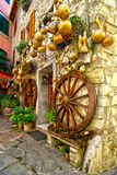House with pumpkins. Pumpkins and gold wagon wheels decorating a Tuscan house Stock Image