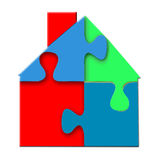 House Puzzle. Bright 3d closeup of connected, colorful puzzle of a house in blue, green, and red, and isolated on a white background Stock Photos