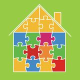 House from puzzles. Small house collected from colour slices Stock Photos