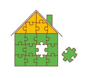 House from puzzles. Small green house from puzzles with the dropped out sliceollected from  slices Royalty Free Stock Images