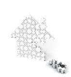 House of puzzles on white. House of many puzzles on white background Royalty Free Stock Photography