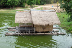 House on the raft. Home vetiver and bamboo structure on the raft in the reservoir, Thailand Stock Photography