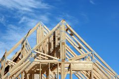 House Rafters 1. Wooden rafters of a new home under construction stock image