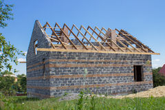 House rafters. Construction in progress house with wooden roof rafters stock image