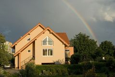 HOUSE WITH RAINBOW Royalty Free Stock Photos